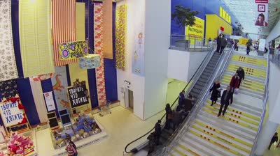 samara by stairs and ride on escalator in store ikea aerial