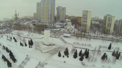 samara city traffic near residential complex rook and stela rook at winter