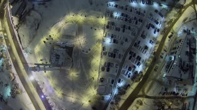 samara square with monument of rocket soyuz and car traffic at winter night